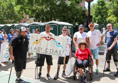 Featured in this photo is East Coast O&P's Patient Advocate Robert and Ron a Prosthetic Technician along with some patients.